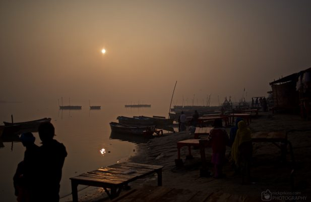 Boats and people beside Ganges River